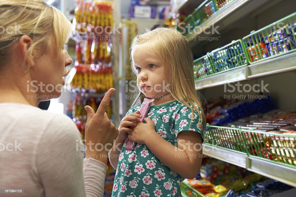 Girl Having Arguement With Mother At Candy Counter In Supermarket stock photo