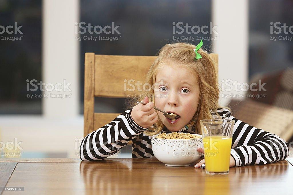 Girl having breakfast royalty-free stock photo