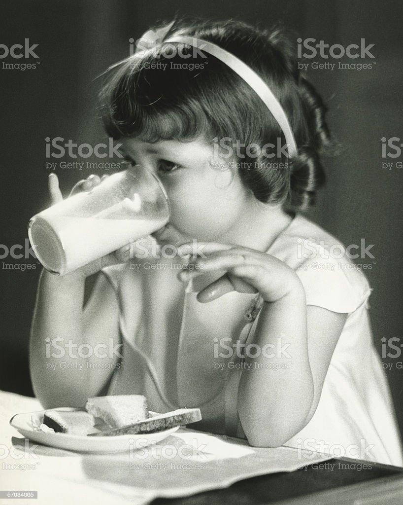 Girl (4-5) having breakfast, (B&W) royalty-free stock photo