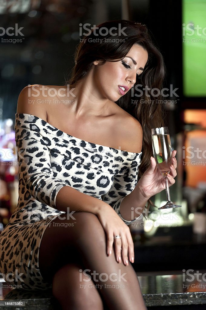 Girl having champagne at a bar royalty-free stock photo