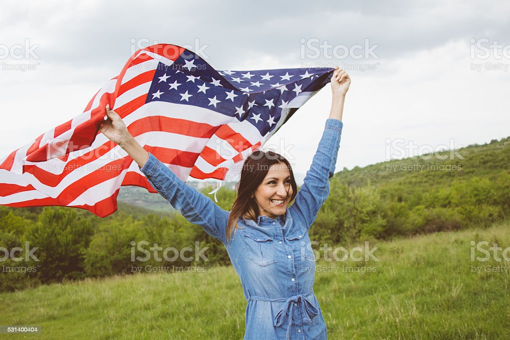Girl having enjoyable independence day outdoor stock photo