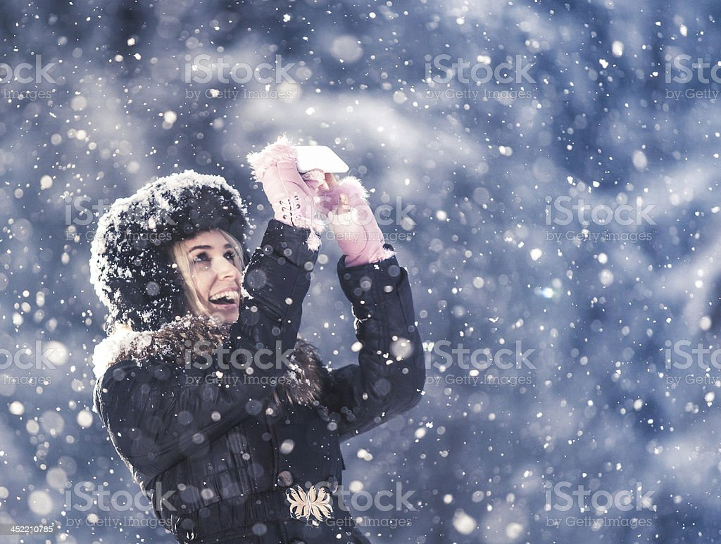 Girl having fun at the cold winter and snow royalty-free stock photo