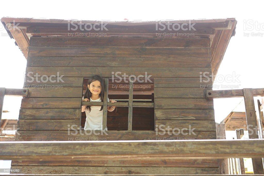 Girl Having Fun in the Play House stock photo