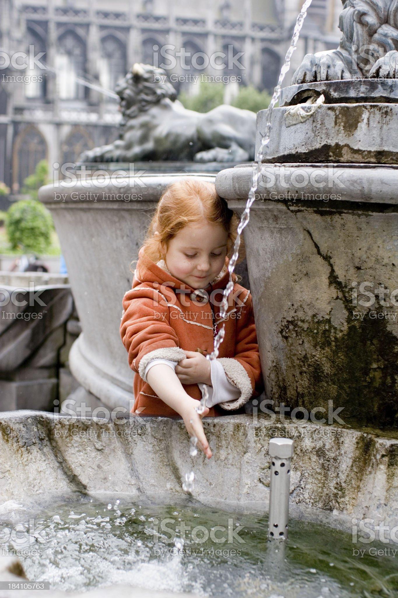 girl having fun with a fountain royalty-free stock photo