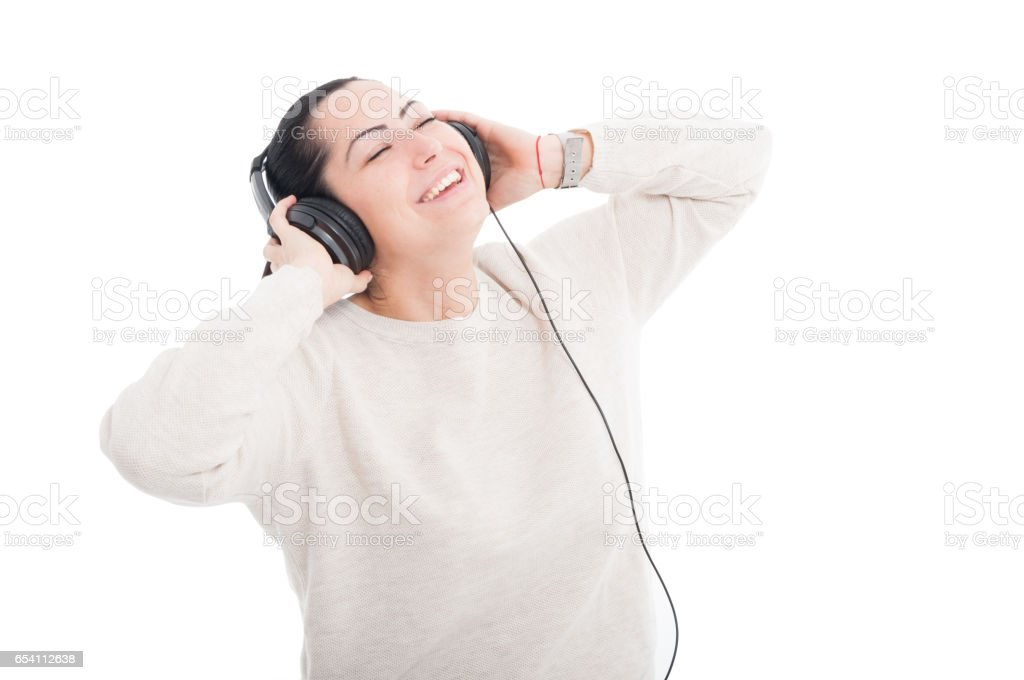 Girl having relaxing moments with headphones stock photo