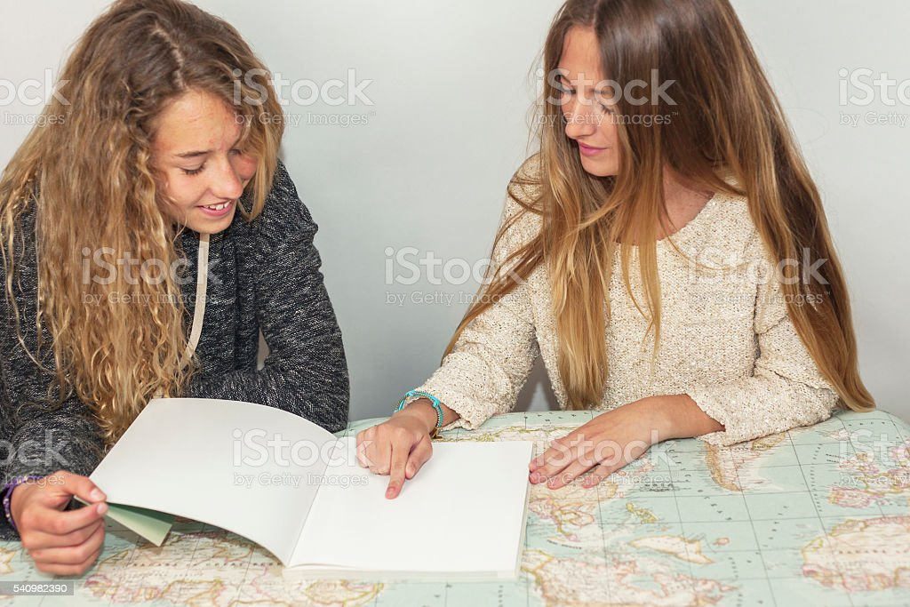 Girl helping little sister with her homework stock photo