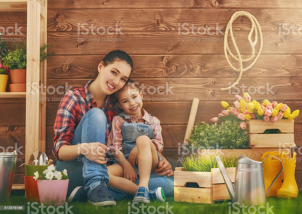 girl helps her mother stock photo