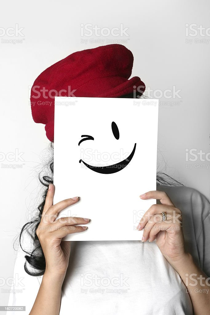 girl hiding a smiley face royalty-free stock photo