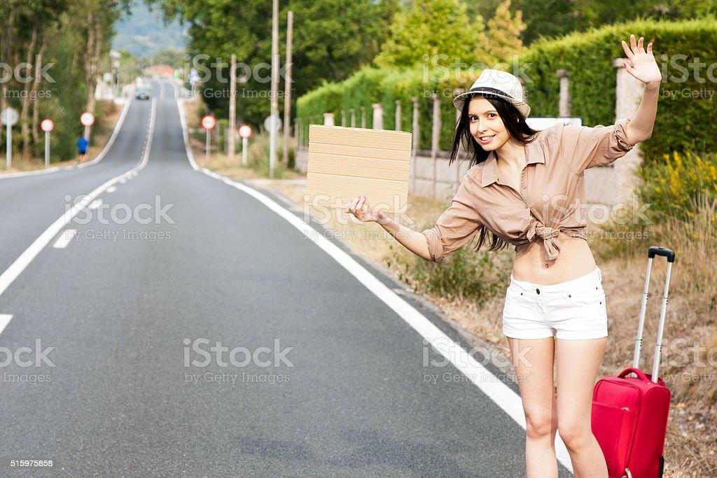 girl hitchhiking stock photo