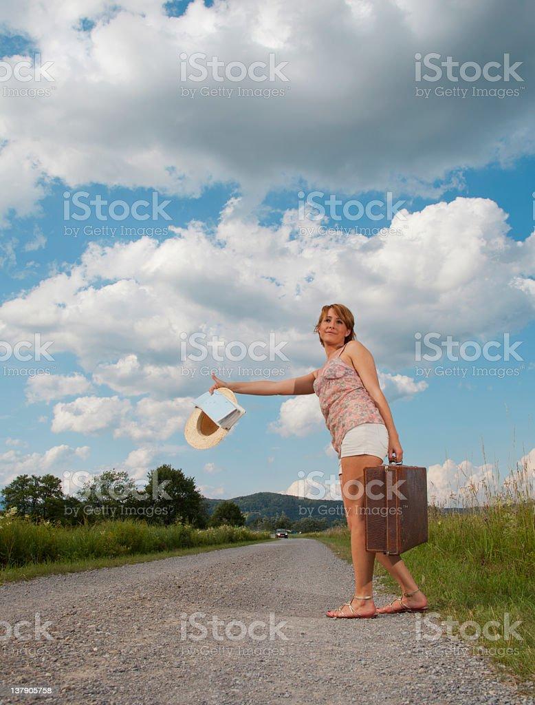 Girl hitchiking stock photo