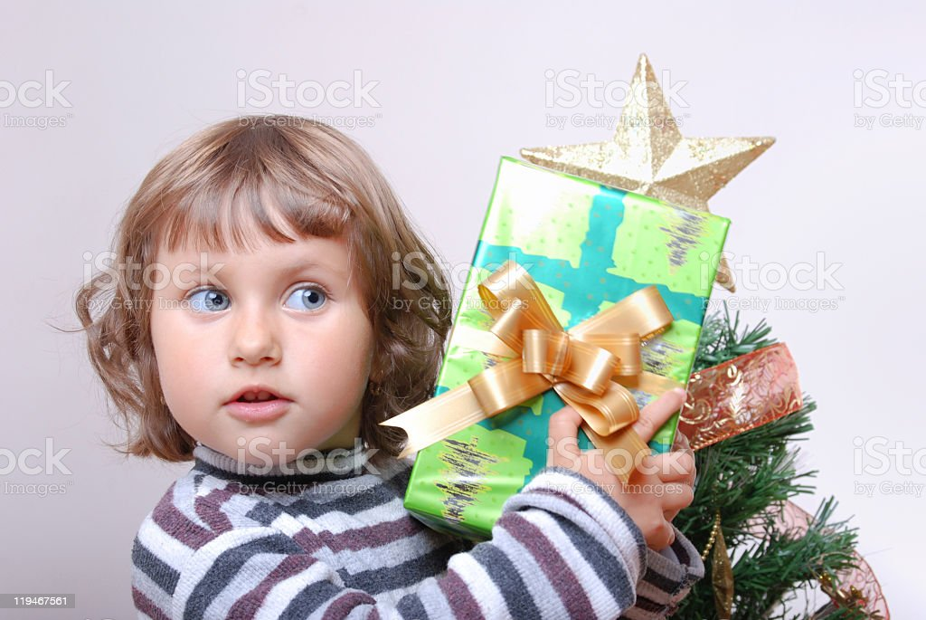 Girl hold a gift stock photo