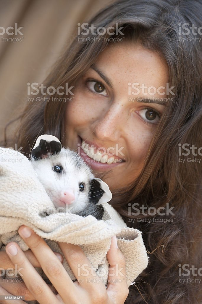 Girl holding a Baby Opossum royalty-free stock photo
