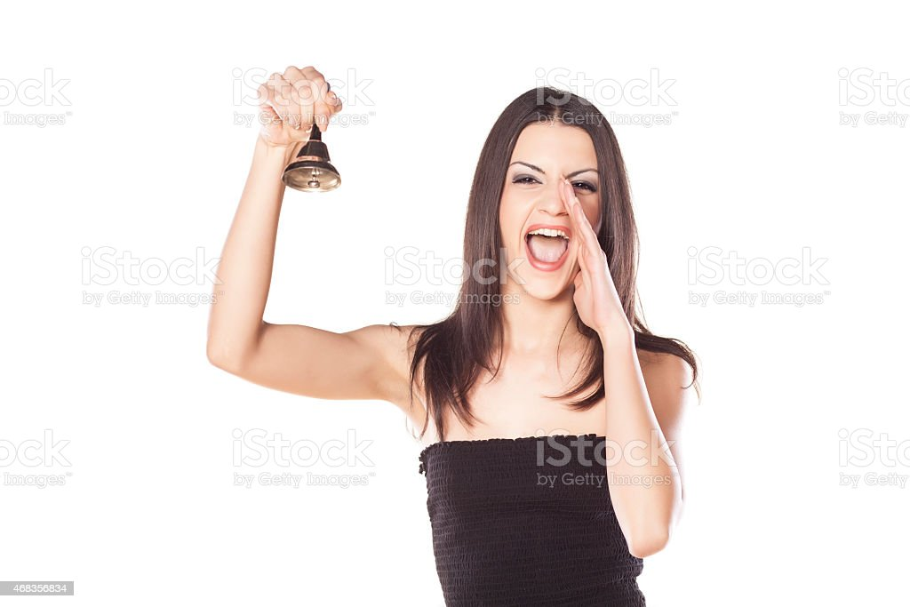 girl holding a bell stock photo