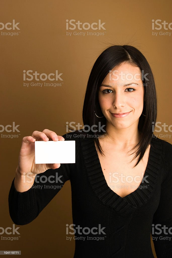 Girl holding a blank business of gift card royalty-free stock photo