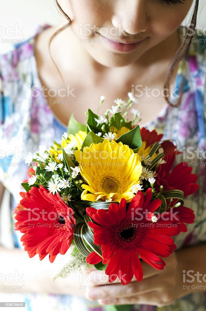 Girl holding a bouquet of flowers royalty-free stock photo