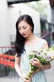 girl holding a bouquet of flowers