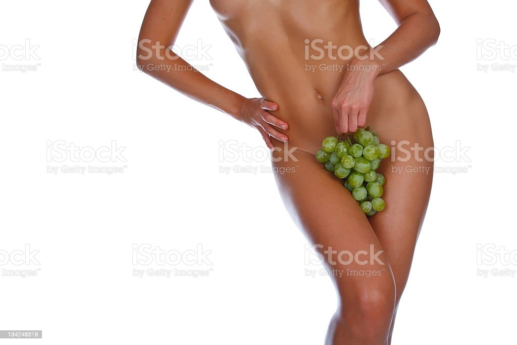 girl holding a bunch of grapes near naked body royalty-free stock photo