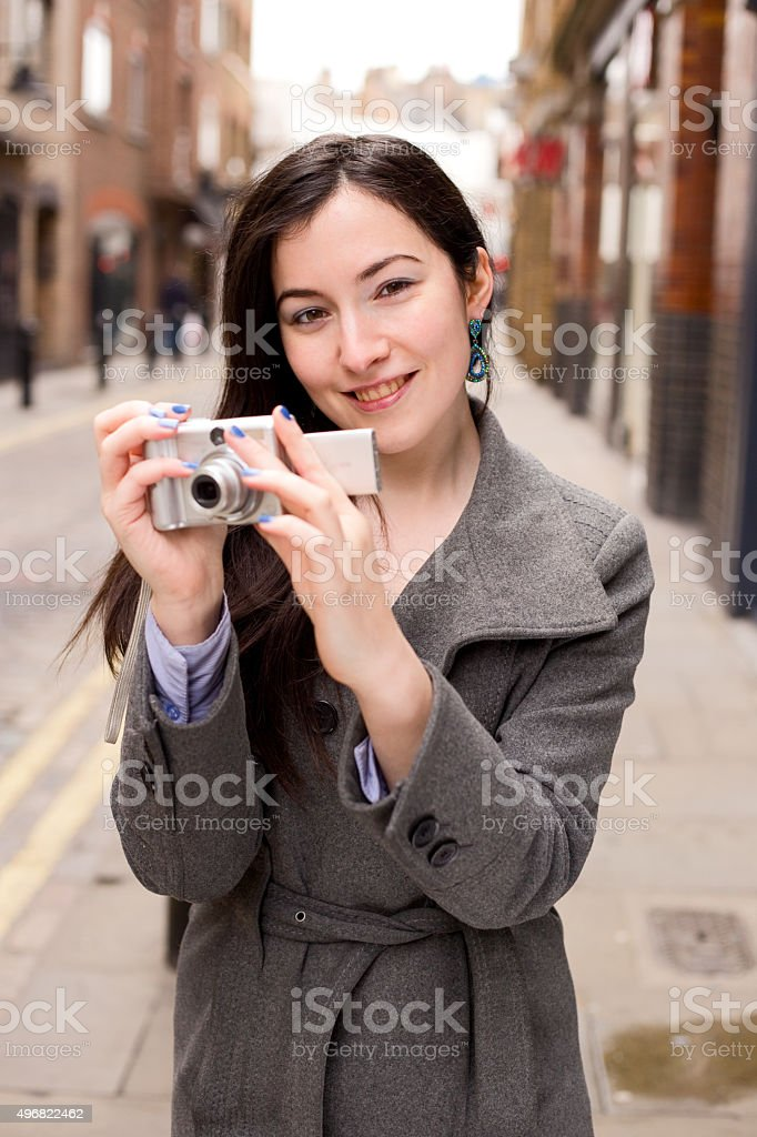 girl holding a camera royalty-free stock photo