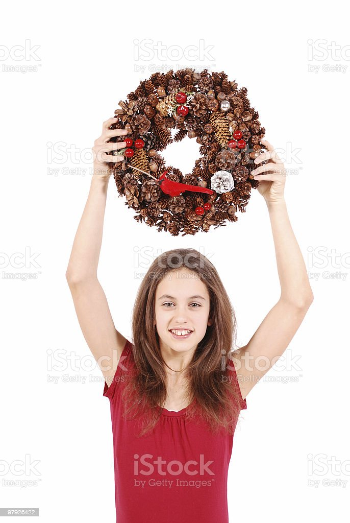 Girl holding a Christmas wreath royalty-free stock photo