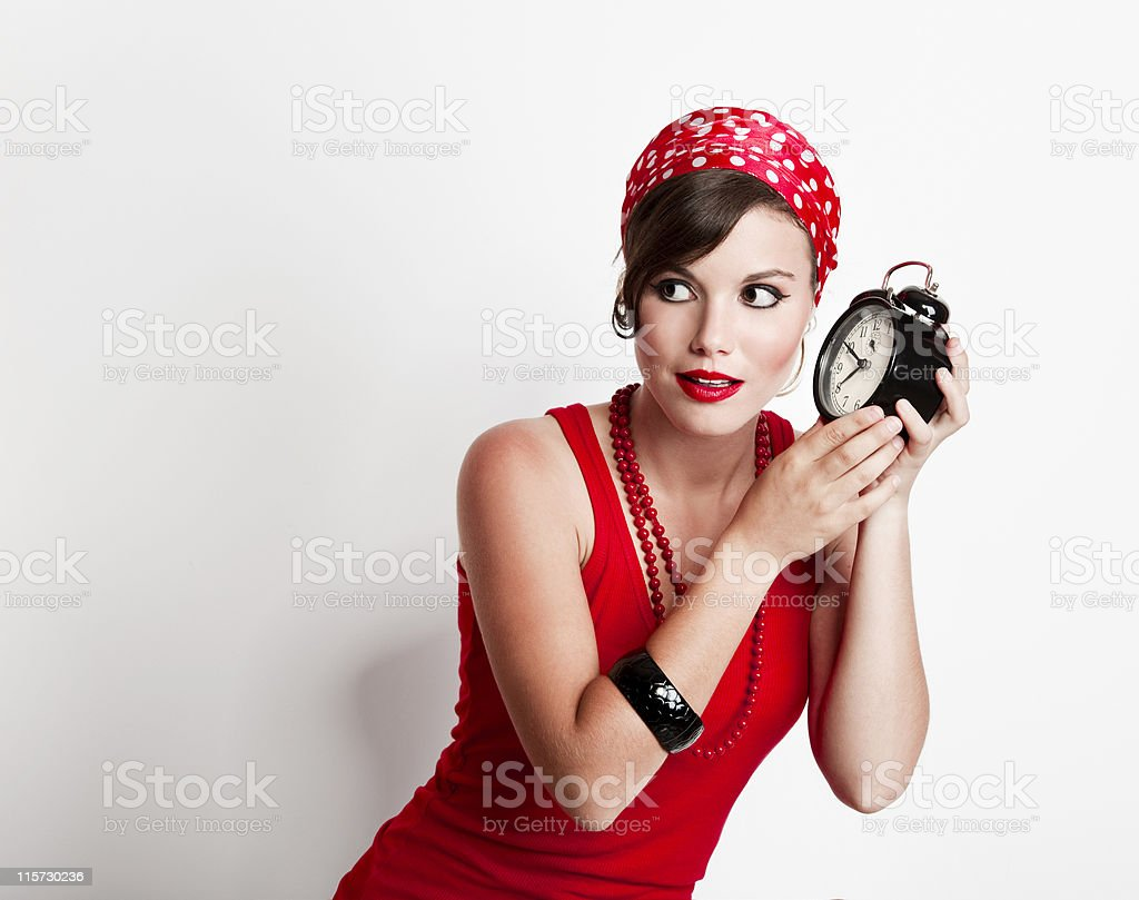 Girl holding a clock royalty-free stock photo