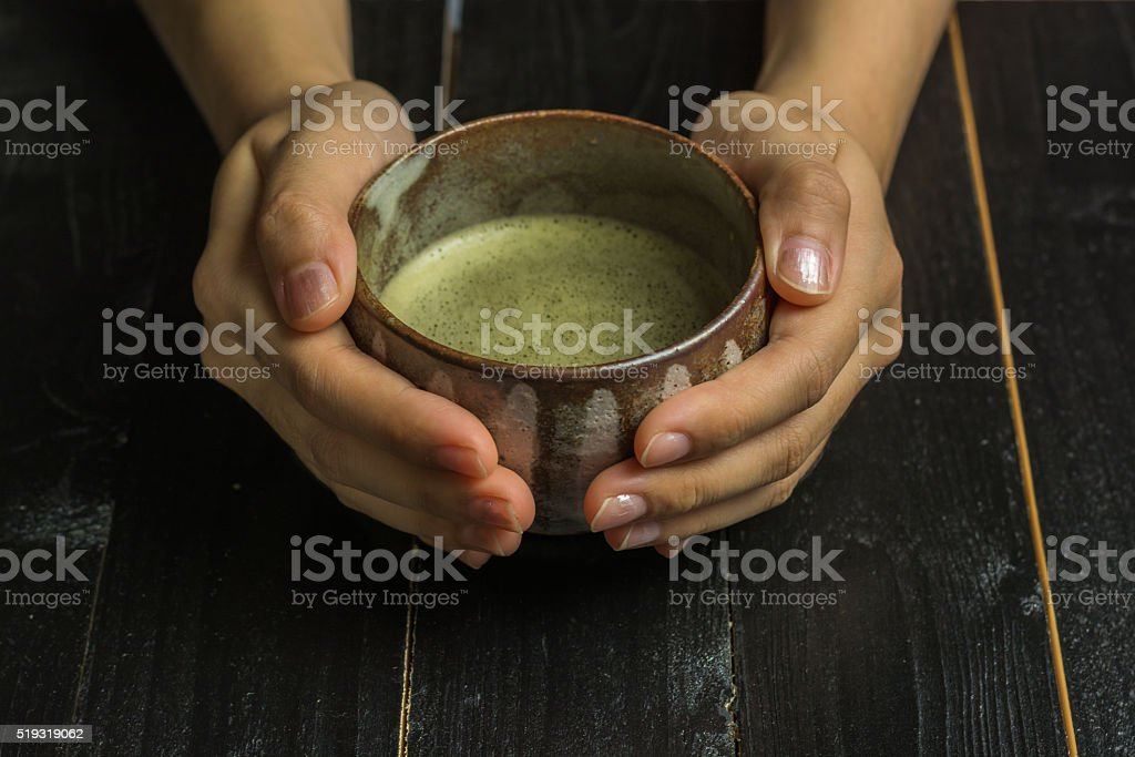 Girl holding a Japanese tea cup royalty-free stock photo