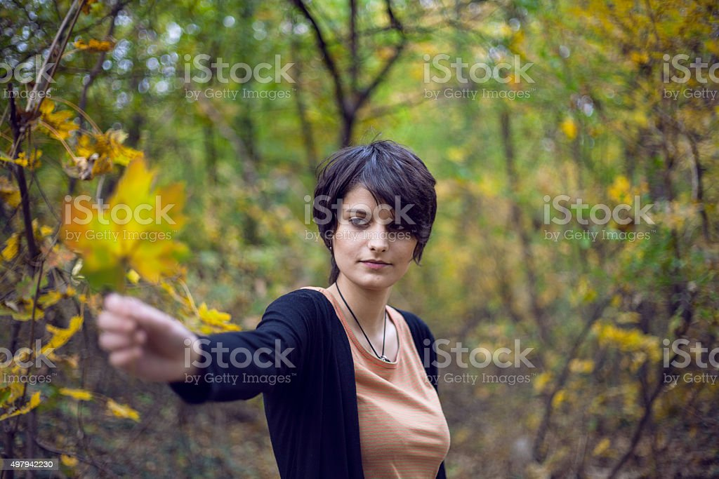 Girl holding a leaf royalty-free stock photo