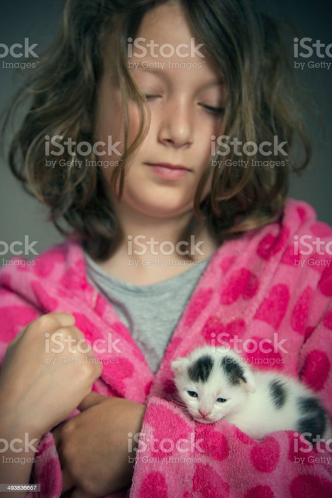 Girl holding a little cat in arms royalty-free stock photo