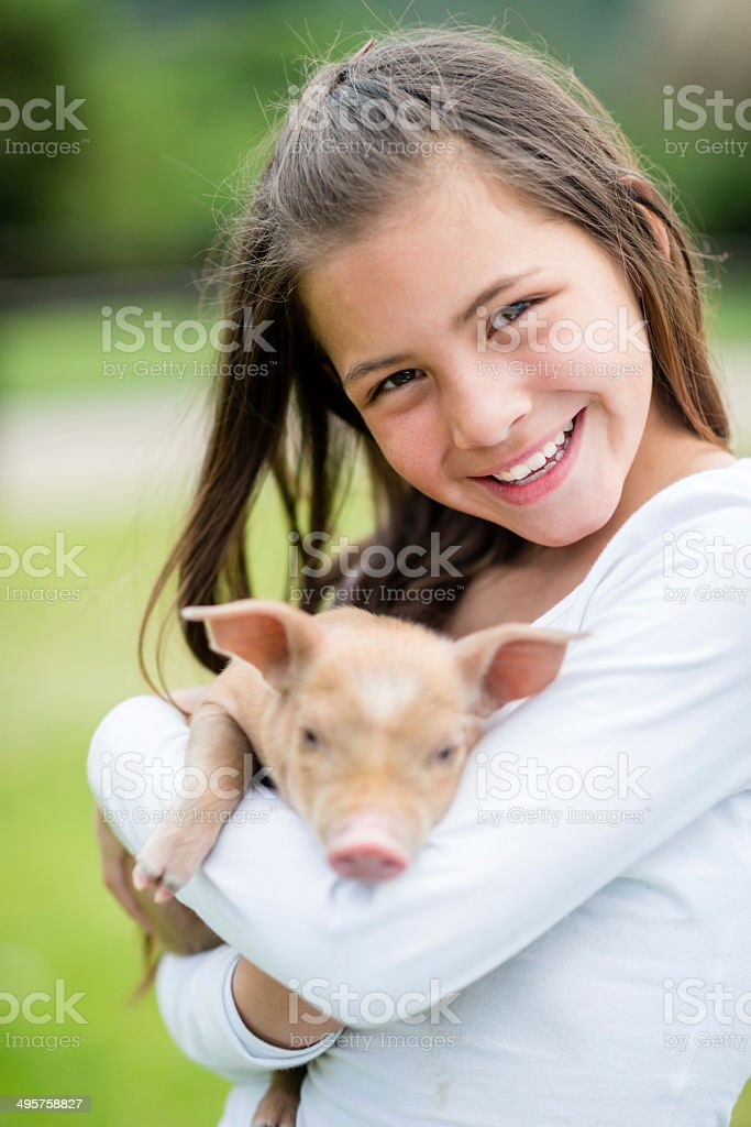Girl holding a pig stock photo