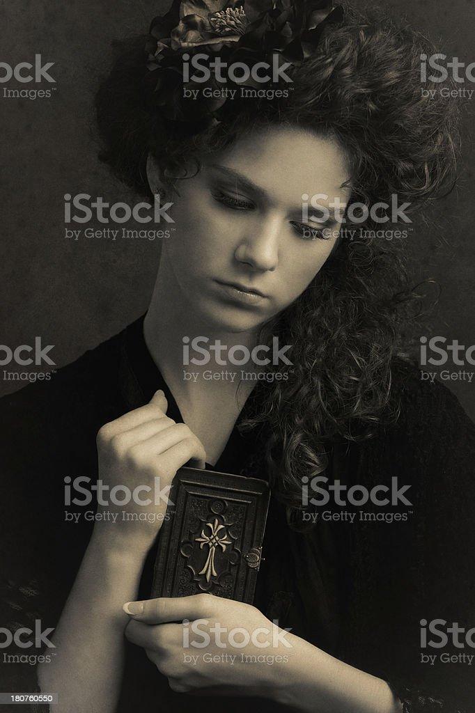 Girl holding a prayer book stock photo