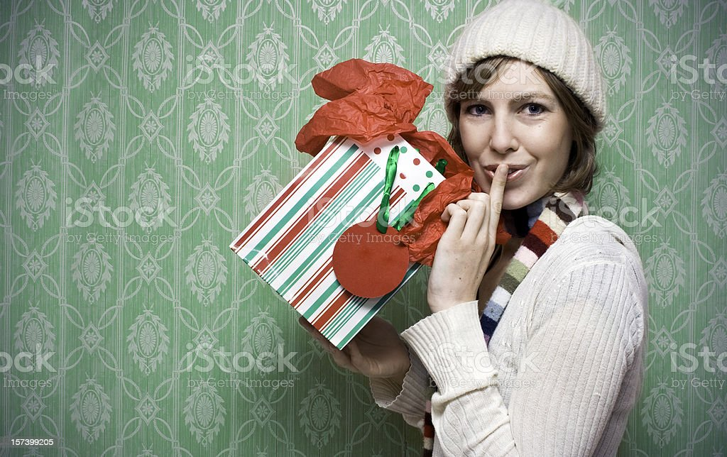 Girl holding a present for the holidays royalty-free stock photo