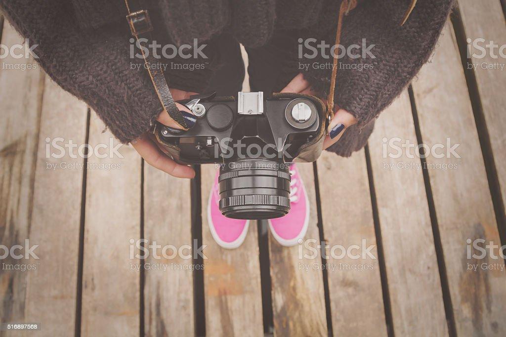 Girl holding a retro camera. stock photo