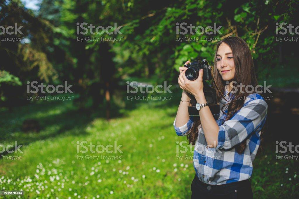 Girl holding a retro camera stock photo
