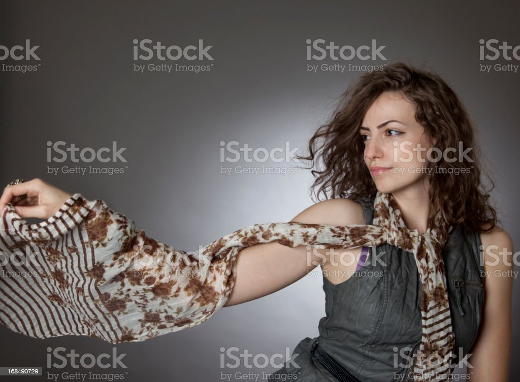 Girl holding a scarf stock photo