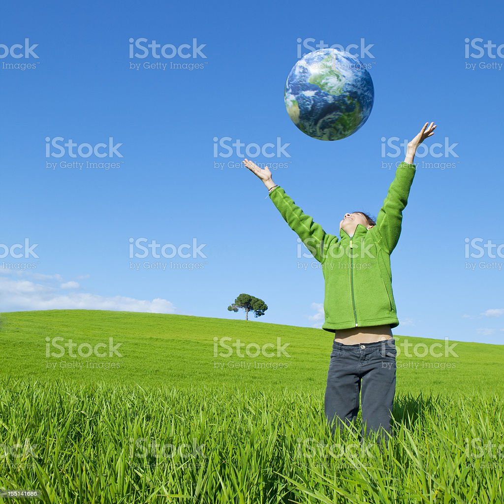 Girl holding a world globe royalty-free stock photo