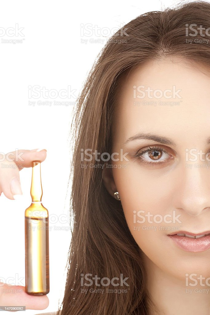 girl holding a yellow ampule royalty-free stock photo