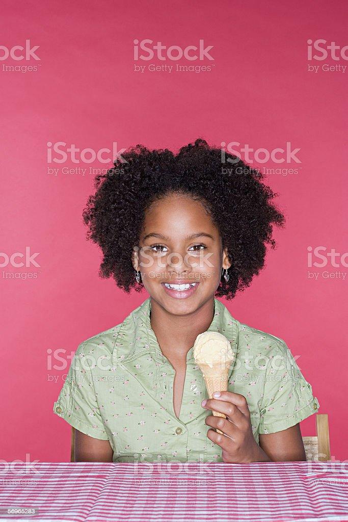 Girl holding an ice cream royalty-free stock photo