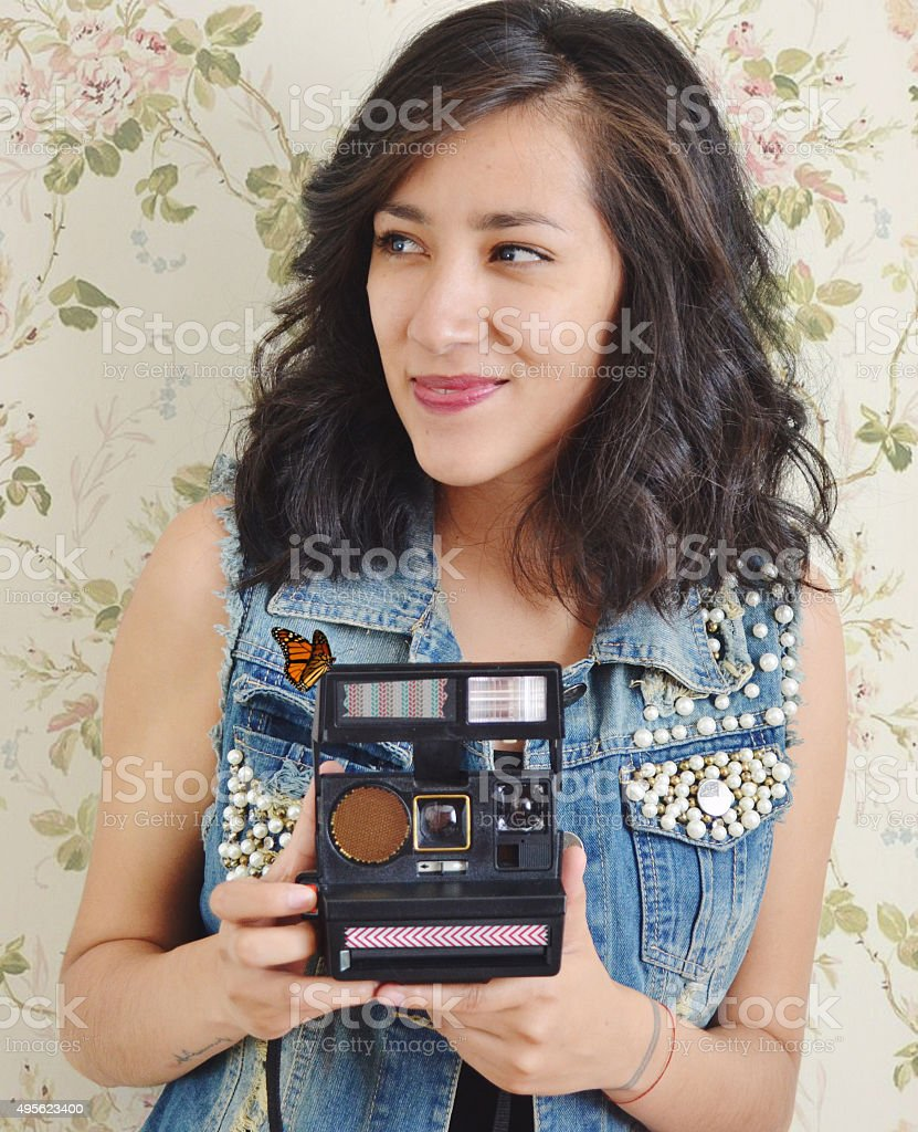 Girl holding an instant camera stock photo