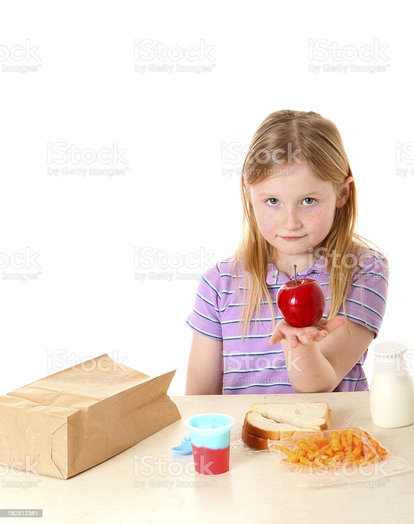 girl holding apple for lunch royalty-free stock photo