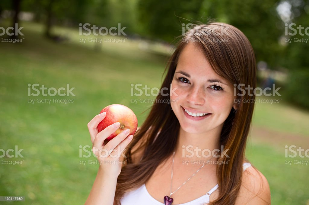 girl holding apple royalty-free stock photo