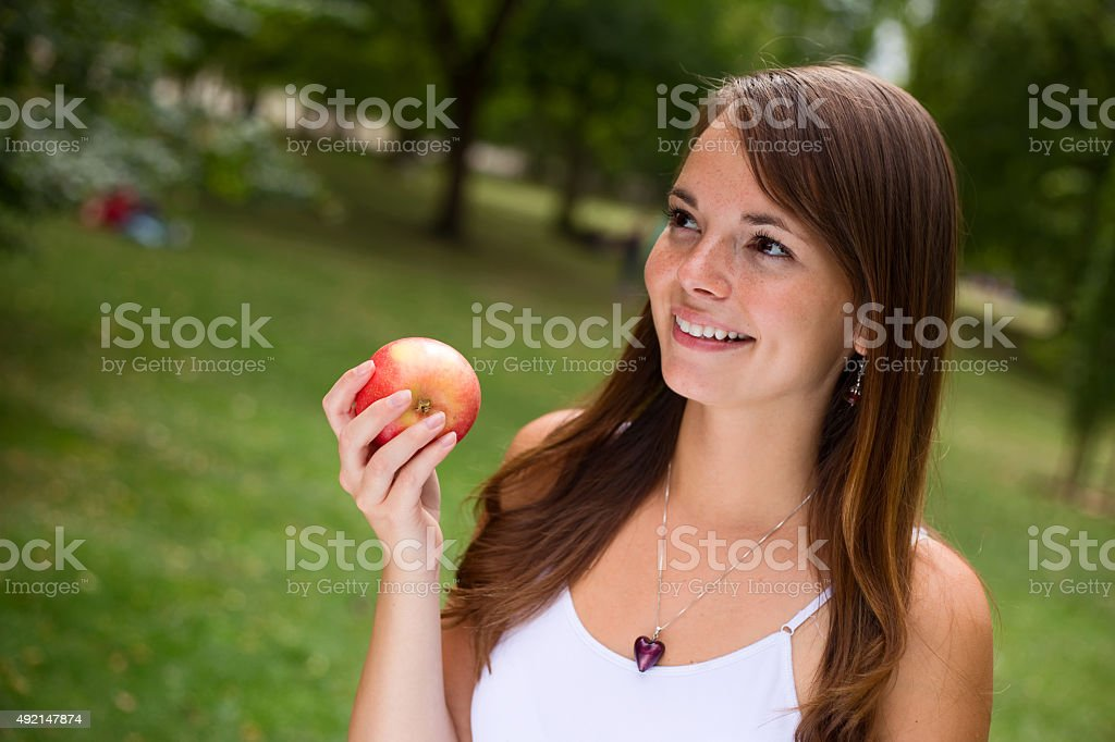 girl holding apple royalty-free stock photo