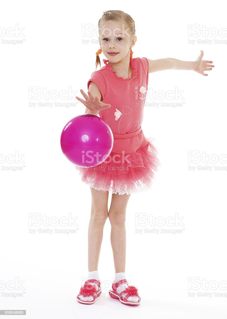Fille tenant le ballon photo libre de droits