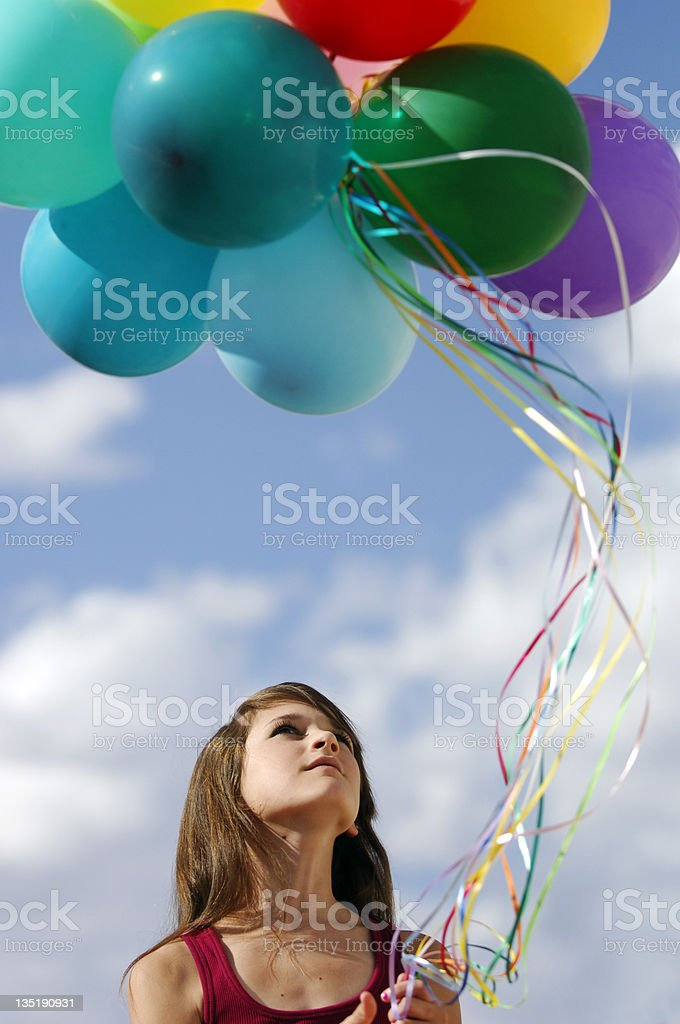 Girl holding balloons royalty-free stock photo