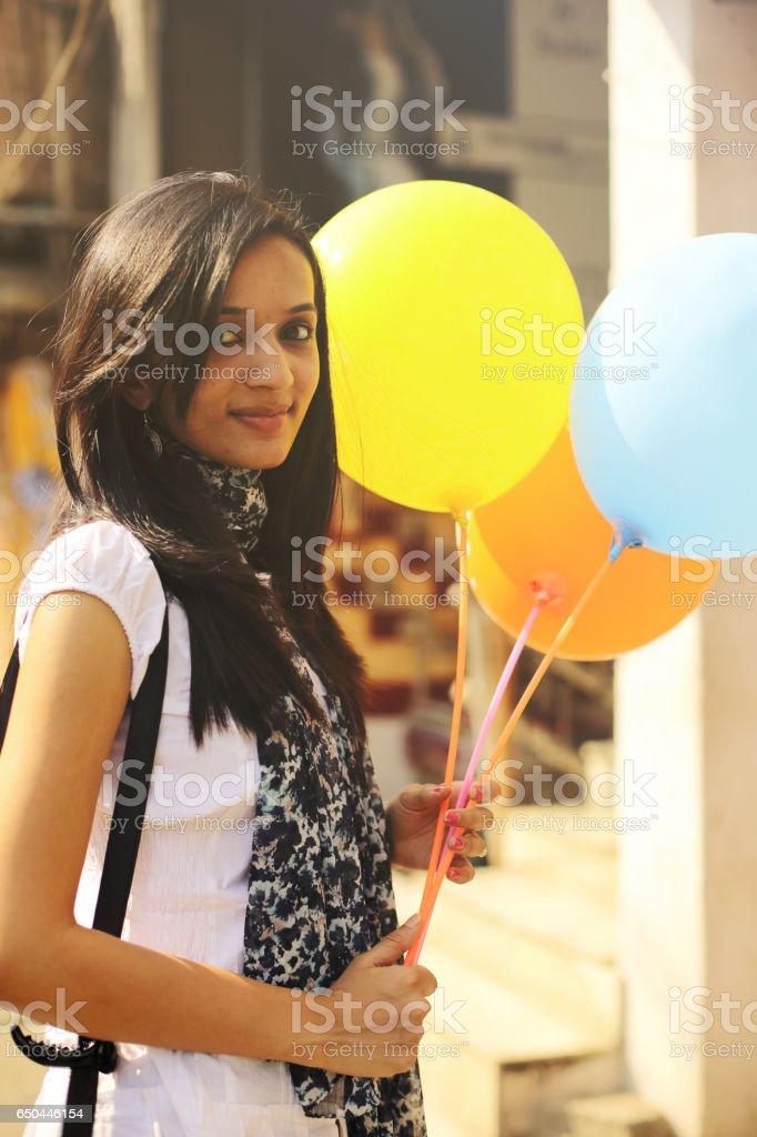 Girl Holding Balloons stock photo