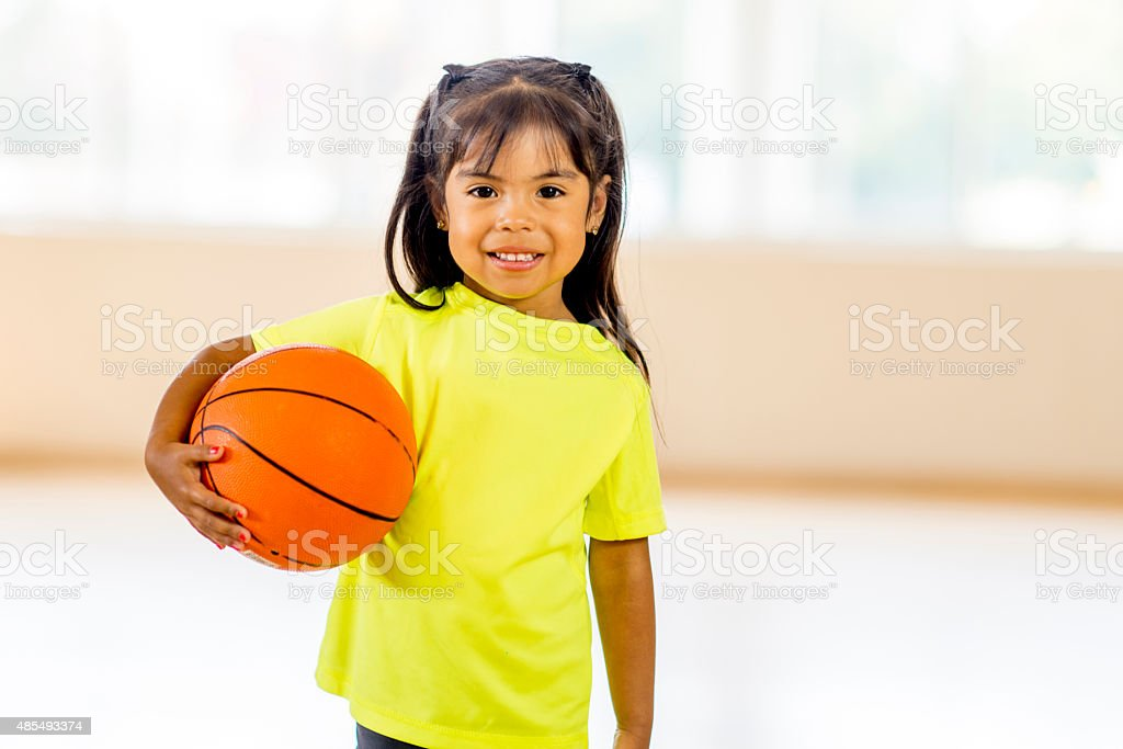 Girl Holding Basketball stock photo