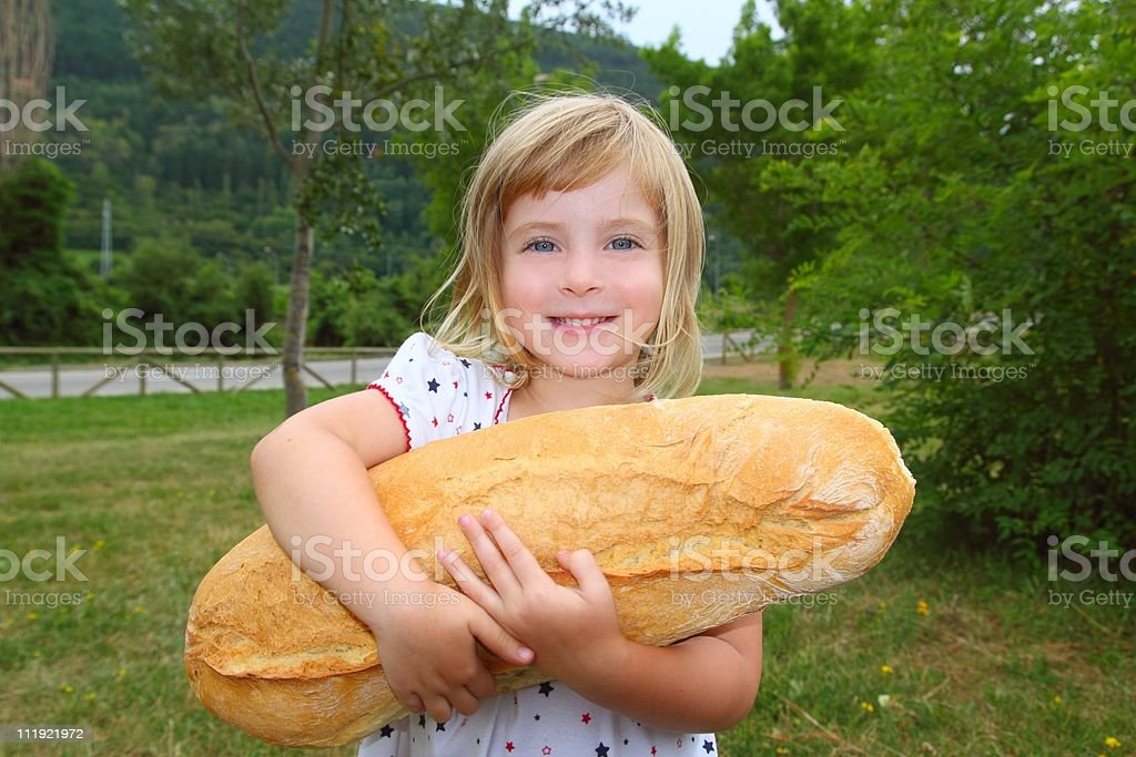 girl holding big bread humor size hungry child royalty-free stock photo