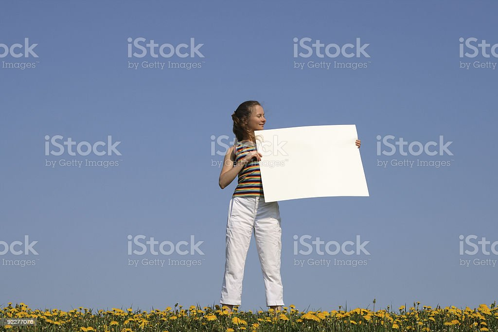 Girl holding blank banner with copy space royalty-free stock photo