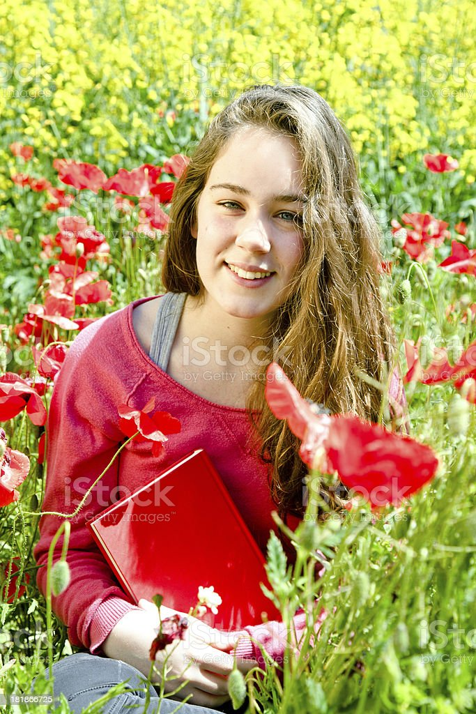 Girl holding book outdoors royalty-free stock photo