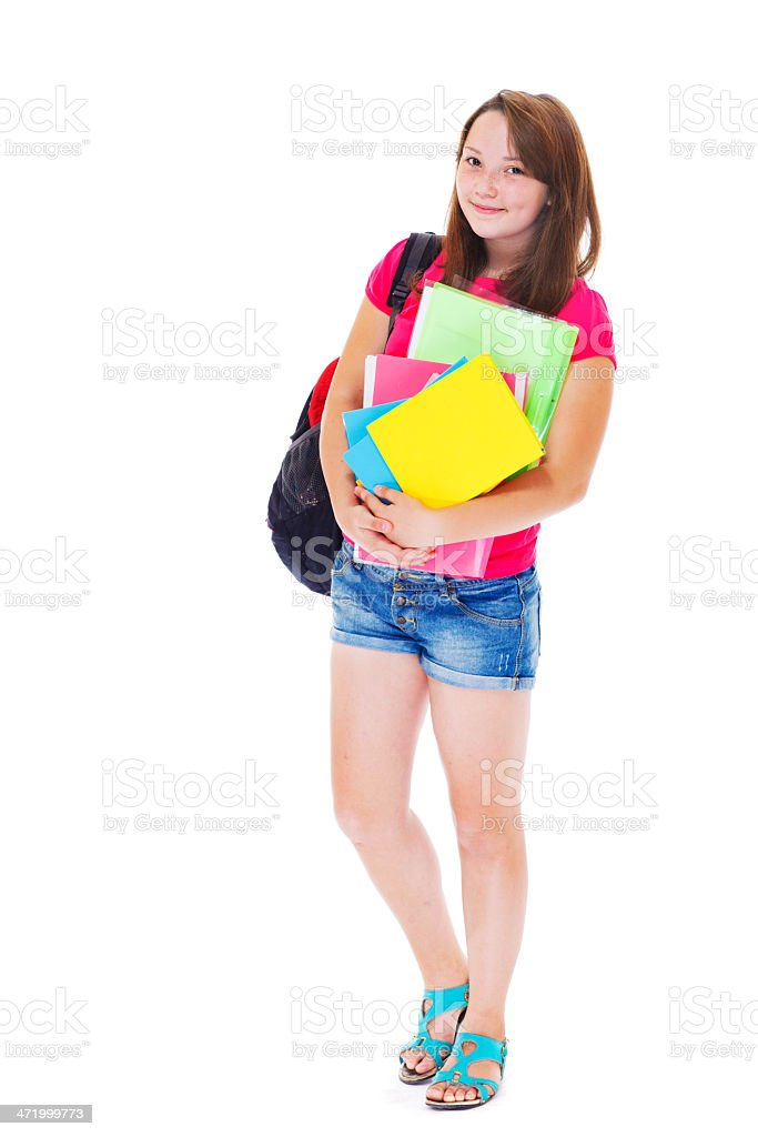 A girl holding books and a book bag stock photo