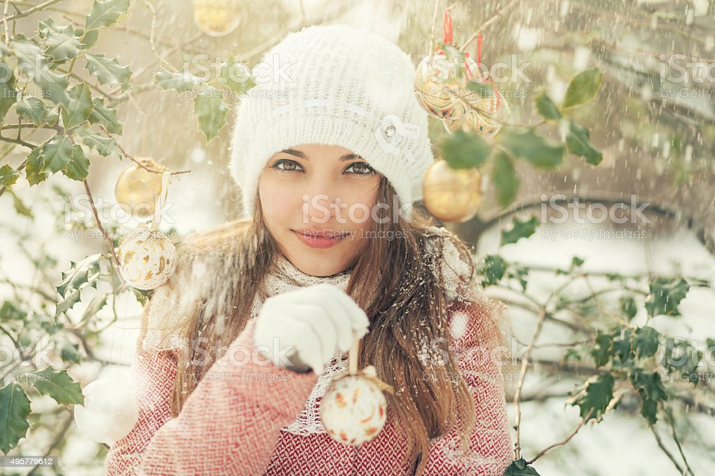 girl holding christmas ball stock photo