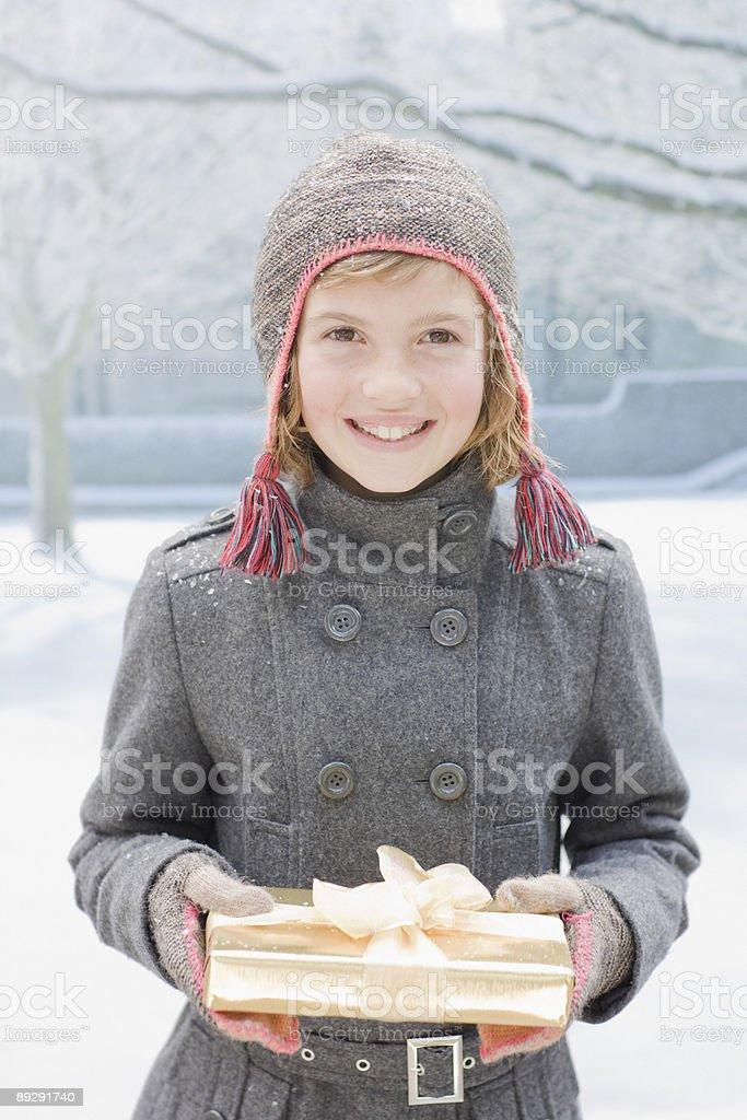 Girl holding Christmas gift royalty-free stock photo